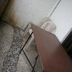 at the balcony.. dirty chairs and table :(