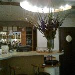 the bar with enormous bunch of gladioli