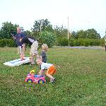 Family fun in the yard at Skyline View Cabins!
