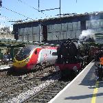 """Fellsman"" steam train at Carlisle alongside modern equivalent"