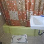  The lovely yellow tub, with the paper bath mat