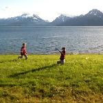 the kids enjoying the midnight sun on the terrace of the lodge