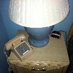 nightstand with non-working lamp and mystery phone