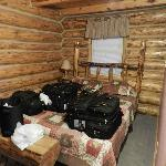 Queen size bed in the bedroom of cabin #7