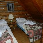  Double beds in the loft in cabin #7.  Very comfy (don&#39;t mind mess)