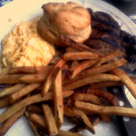 Steak and Eggs with scrambled eggs and french fries