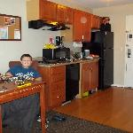 My son setting up his Legos in our room. Great kitchen!