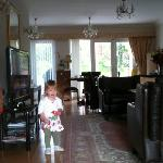 our daughter standing in the lovely bright living room