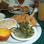 Great meal of Fried Chicken Greens, Northern Beans, and Cornbread Muffin, a tall cold glass of V