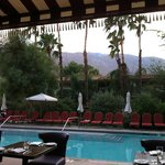 view of the mountains and pool area from patio dining