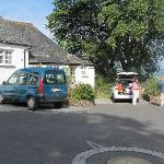 Car parking outside each of the cottages.