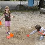 My daughter and her friend playing in the sand box at Daniels
