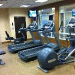 exercise room overlooking indoor pool