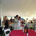 Joyful embrace in reception tent