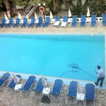 swimming pool being cleaned