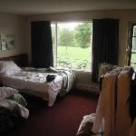 room with two double beds and a rollaway, north side