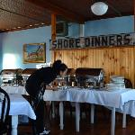 Indoor dining room with historic shore dinner sign