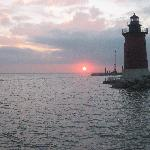  cruising past the East End Light, in Lewes Harbor