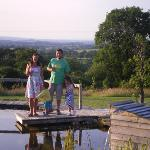 Guests enjoying a pre-supper drink by the pond