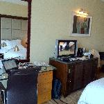 Working table and TV, a nice TV with limited choice of with some famous international channels.