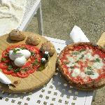 A lovely caprese salad and pizza while swimming at Sasso by the Sea