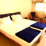  American size beds, LCD TVs, individually controlled air-conditioning, ceiling fans