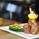 Grecian seasoned Lamb Chops with a grilled lemon wheel, lemon roasted potatoes and grilled zucch
