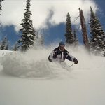 Cat skiing fresh powder behind Schweitzer Mountain resort