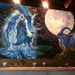 Painting in middle of restaurant.