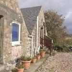 View of the back field and front door of the Bothy