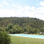 the pool set amongst forest covered hills