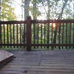  The back deck has a hot tub and porch swing.