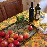 Gifts of produce, wine, and olive oil.