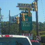 Motel sign. Appearently, There's a Waffle House in front of it.