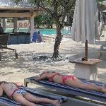 The girls get some sun by the main pool and pool bar