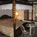 Four poster canopy bed.