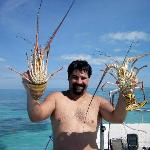 Rick holding the lobsters, Sonny caught
