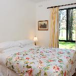 Queen size bed in the second bedroom of Units 1 & 2 - quality linen & towels all provided