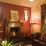 The cosy parlour with open fire place