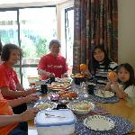 Enjoying breakfast with newly picked fresh fruits and yummy home-made goodies prepared by Bev