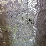 bird pop on net curtain. inside room