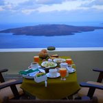 Breakfast for three overlooking the caldera and Nea Kameni