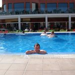 me in the pool, you can see the pool bar and resturant behind me
