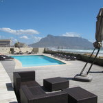 The hotel patio, pool with backdrop of Table Mountain