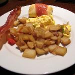 hot buffet includes, eggs, potatoes, bacon, sausage, strawberry  blintzes