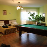 Beds and pool table; door to balcony