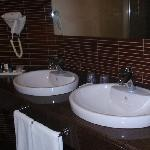  all bathrooms include two wash basins, a big tub with shower, a toilet and a bidet.