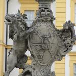 lion holding a coat of arms