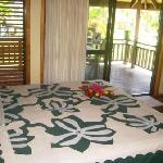 Kingsize bed with tivaivai bed cover