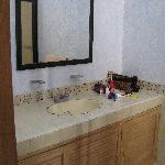 Bathroom counter. Roomy shower  as well.